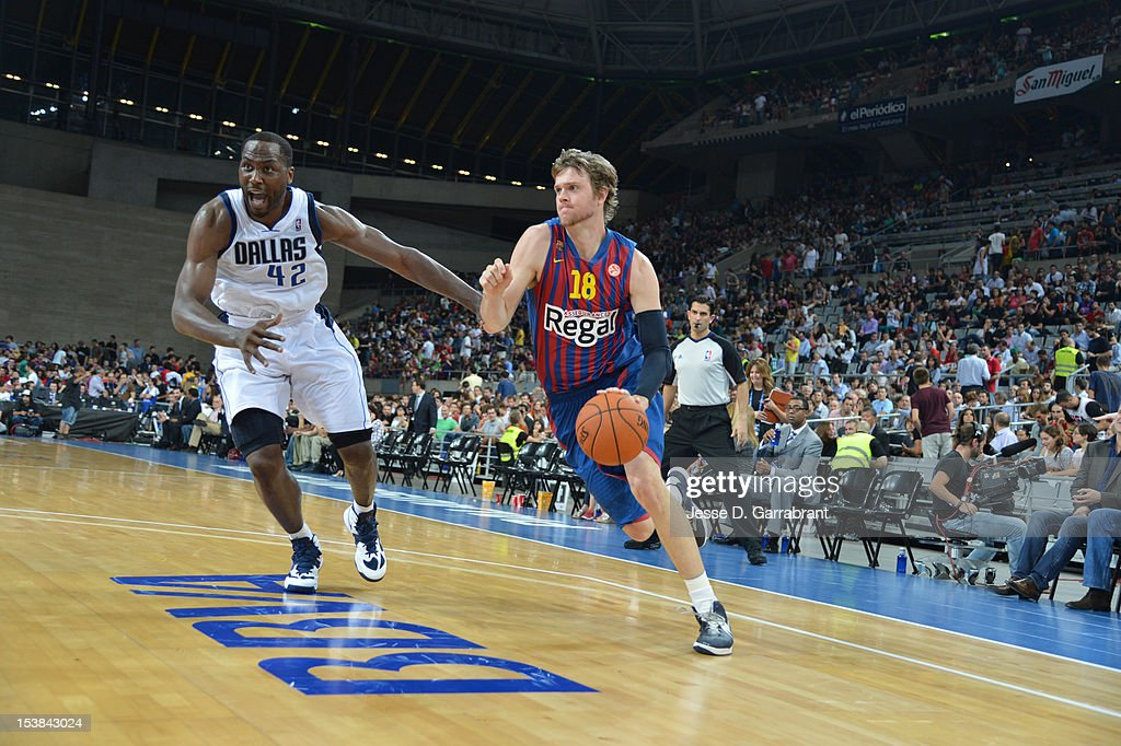 Judson Wallace #18 of F.C. Barcelona Regal drives against <a gi-track='captionPersonalityLinkClicked' href=/galleries/search?phrase=Elton+Brand&family=editorial&specificpeople=201501 ng-click='$event.stopPropagation()'>Elton Brand</a> #42 of the Dallas Mavericks during the game at Palau St. Jordi for NBA Europe Live 2012 on October 9, 2012 in Barcelona, Spain.