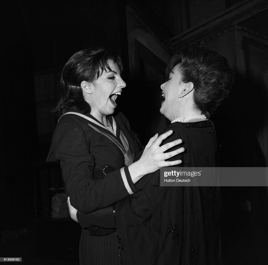 Judy and Liza. American singer and actress Judy Garland greeting her daughter, actress and singer Liza Minnelli, 1965. Garland; Judy: (1922-69) American entertainer, born in Grand Rapids, Minnesota. Part of a showbusiness family, she partnered two sisters in a vaudeville act that led to a film contract. Intelligent and vivacious she appeared in some outstanding film musicals, among them 'The Wizard of Oz' 1939, 'Meet Me in St Louis' 1944, and 'Easter Parade' 1948. The emotional power of her voice was evident from her live stage performances, and her outstanding dramatic ability is shown in the film 'A Star is Born' 1954. Despite emotional, medical and financial difficulties and a reputation for unreliability, she achieved the status of a legendary performer and actress, inspiring a huge amount of love in her audiences throughout the world. Married five times, her
