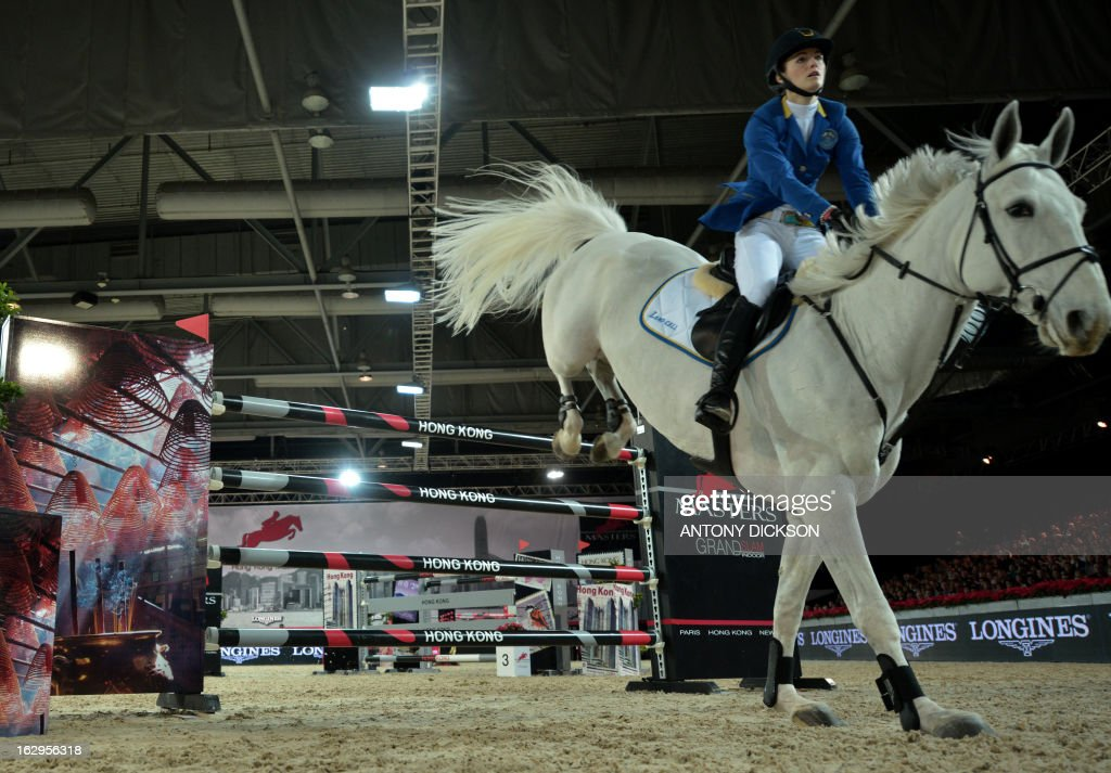 Judy Ann Melchior of Belgium riding As Cold As Ice competes in the international jumping competition Grand Prix equestrian event in Hong Kong on March 2, 2013. AFP PHOTO / Antony DICKSON