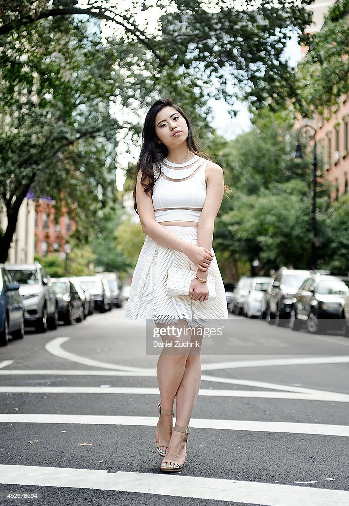 Judy C. Yang is seen around the East Village wearing a Tobi top, Forever 21 skirt, Calvin Klein shoes, Victorias Secret bag and a Michael Kors bracelet on July 31, 2014 in New York City.