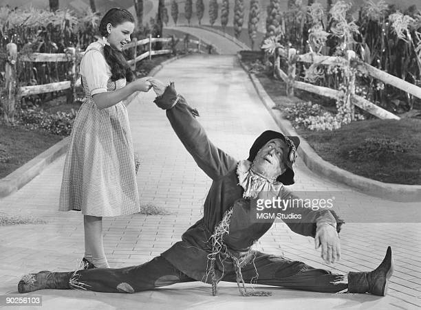 Judy Garland as Dorothy and Ray Bolger as the Scarecrow in the MGM film 'The Wizard of Oz' 1939