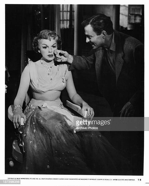 Judy Garland has tear wiped away by James Mason in a scene from the film 'A Star Is Born' 1954