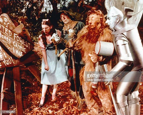 Judy Garland US actress and singer Ray Bolger US actor Bert Lahr US actor and comedian and Jack Haley US actor all in costume in a publicity still...