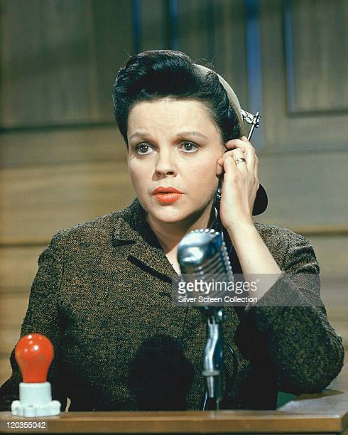 Judy Garland US actress and singer speaking into a microphone in a publicity still issued for the film 'Judgement at Nuremberg' USA 1961 The drama...