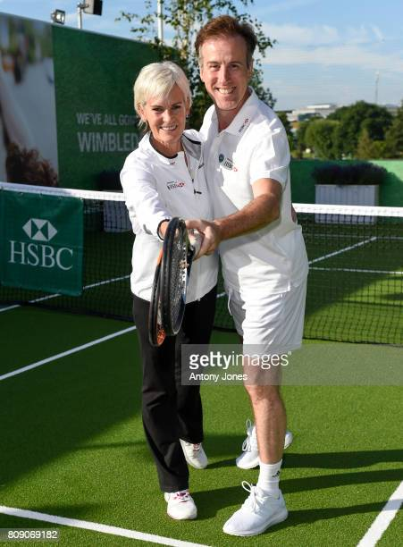 Judy Murray and Anton du Beke pose for pictures during a tennis lesson to promote HSBC's sponsorship of Wimbledon on HSBC Court 20 at the All England...