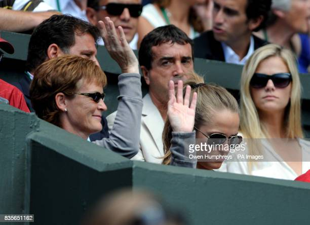 Judy Murray and Kim Sears watch Great Britain's Andy Murray in action against USA's Andy Roddick during the Wimbledon Championships at the All...