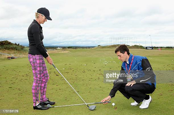 Judy Murray receives a golf lesson during the first round of the Ricoh Women's British Open at the Old Course St Andrews on August 1 2013 in St...