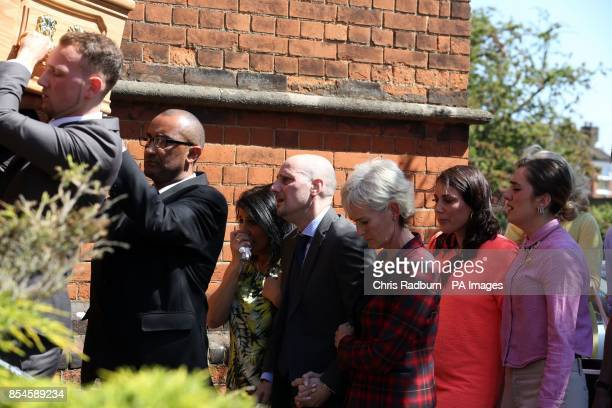 Judy Murray with Nino Severino follows the coffin of former tennis player Elena Baltacha as it is carried into St Johns Church in Ipswich Suffolk for...