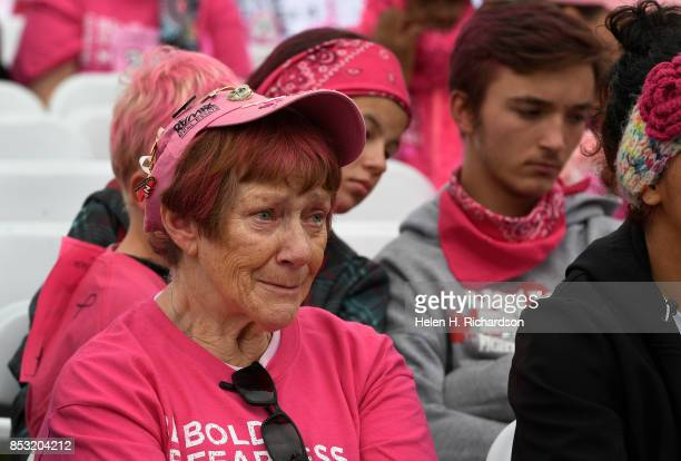 DENVER CO SEPTEMBER 24 Judy Smith a two time cancer survivor gets emotional as she listens to a speaker talk about her own battle with metastatic...