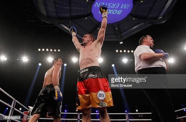 Juergen Braehmer of Germany celebrates after winning the WBO European Championship Light Heavyweight title fight vs Eduard Gutknecht of Germany at...