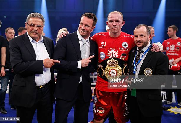 Juergen Braehmer of Germany pose with promotor Kalle Sauerland manager Peter Hanraths and Jesper Jensen of WBA after winning the WBA light...