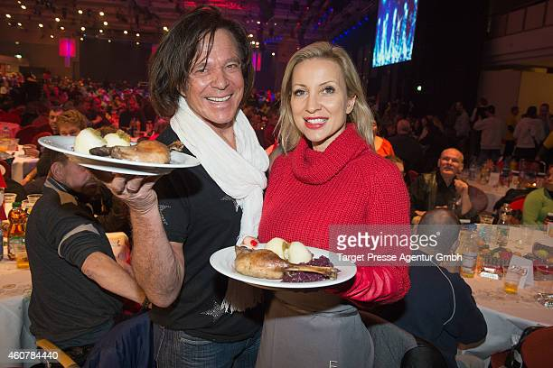 Juergen Drews and Ramona Drews attend the Charity Dinner for Homeless hosted by Frank Zander at the Estrel Hotel in Berlin on December 22 2014 in...