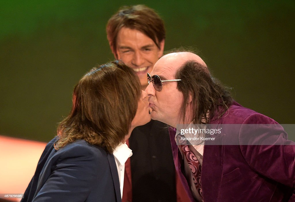 Juergen Drews kisses Gildo Horn during the national tv show 'Willkommen bei Carmen Nebel' at TUI Arena on March 28 2015 in Hanover Germany