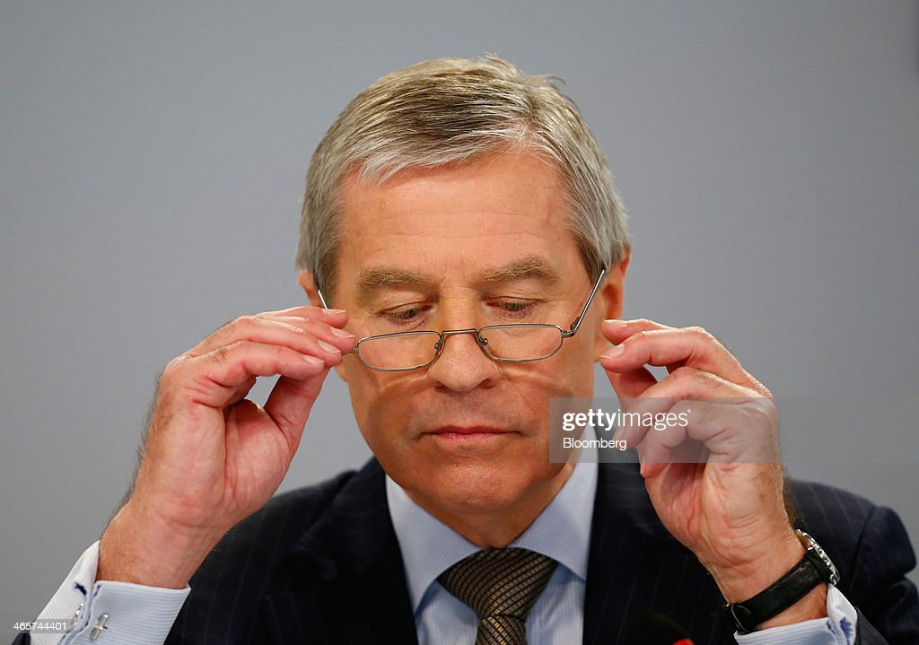 Juergen Fitschen, co-chief executive officer of Deutsche Bank AG, adjusts his spectacles during a news conference to announce the bank's results at their headquarters in Frankfurt, Germany, on Wednesday, Jan. 29, 2014. Deutsche Bank AG, Germany's biggest bank, cut total compensation for employees at its investment bank 23 percent in the fourth quarter as a slide in revenue contributed to a loss for the period. Photographer: Ralph Orlowski/Bloomberg via Getty Images