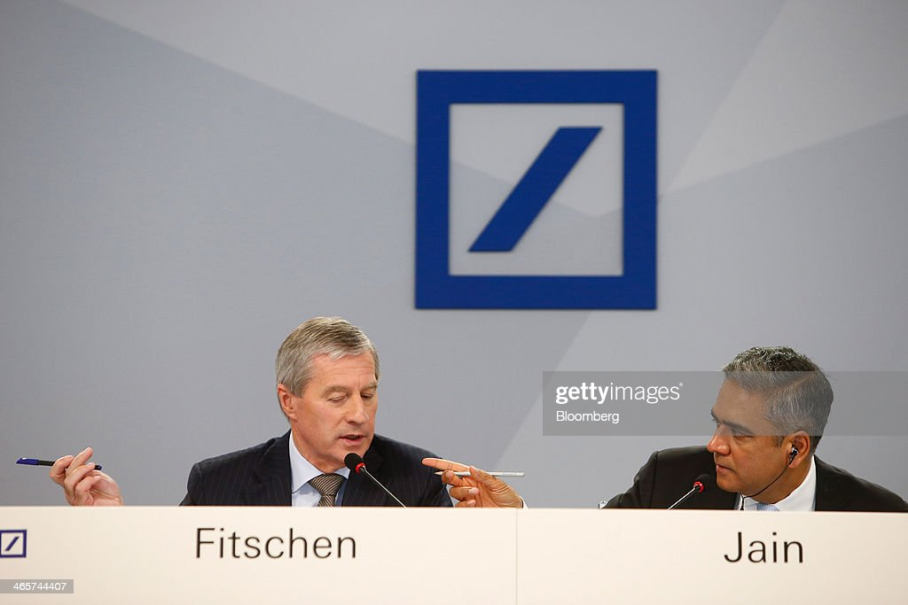 <a gi-track='captionPersonalityLinkClicked' href=/galleries/search?phrase=Juergen+Fitschen&family=editorial&specificpeople=3093173 ng-click='$event.stopPropagation()'>Juergen Fitschen</a>, co-chief executive officer of Deutsche Bank AG, left, speaks as he sits beside Anshu Jain, co-chief executive officer of Deutsche Bank AG, during a news conference to announce the bank's results at their headquarters in Frankfurt, Germany, on Wednesday, Jan. 29, 2014. Deutsche Bank AG, Germany's biggest bank, cut total compensation for employees at its investment bank 23 percent in the fourth quarter as a slide in revenue contributed to a loss for the period. Photographer: Ralph Orlowski/Bloomberg via Getty Images
