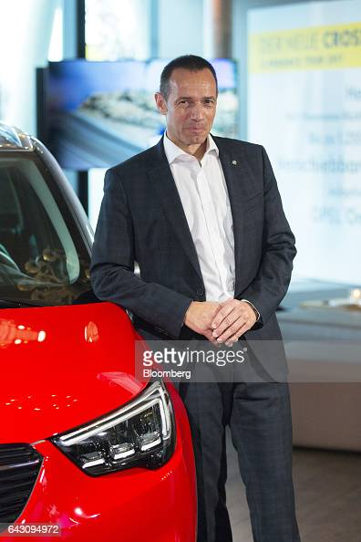 Juergen Keller executive director of sales marketing and aftersales at Adam Opel AG poses for a photograph during the Opel Crossland X sports utility...