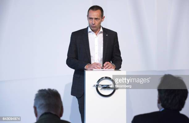 Juergen Keller executive director of sales marketing and aftersales at Adam Opel AG speaks during the Opel Crossland X sports utility vehicle launch...