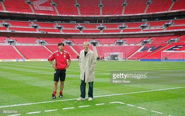 Juergen Klinsmann and germanys head coach Joachim Loew poses for a photo during the German National Football team training session at Wembley stadium...