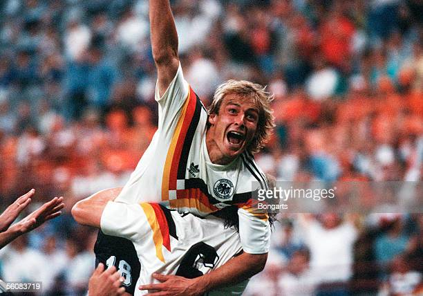 Juergen Klinsmann of Germany celebrate scoring the first goal during the World Cup eighth final match between Netherlands and Germany at the Guiseppe...