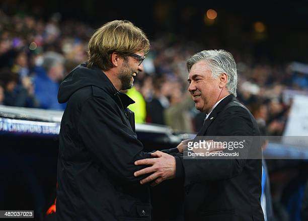 Juergen Klopp coach of Borussia Dortmund is greeted by Carlo Ancelotti coach of Real Madrid during the UEFA Champions League Quarter Final first leg...