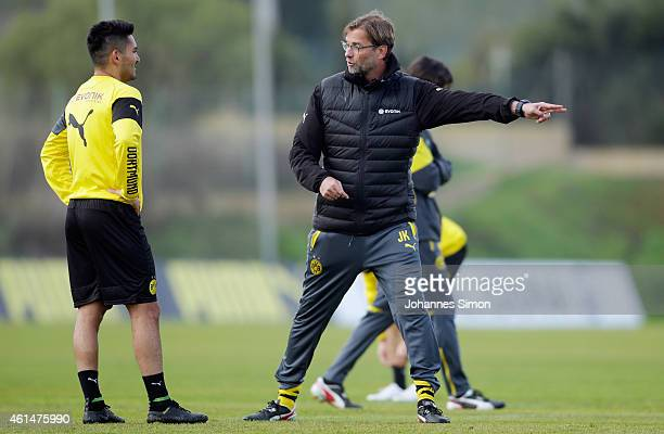 Juergen Klopp head coach of Borussia Dortmund and Ilkay Gundoganattend the morning training session during day 4 of the Borussia Dortmund training...