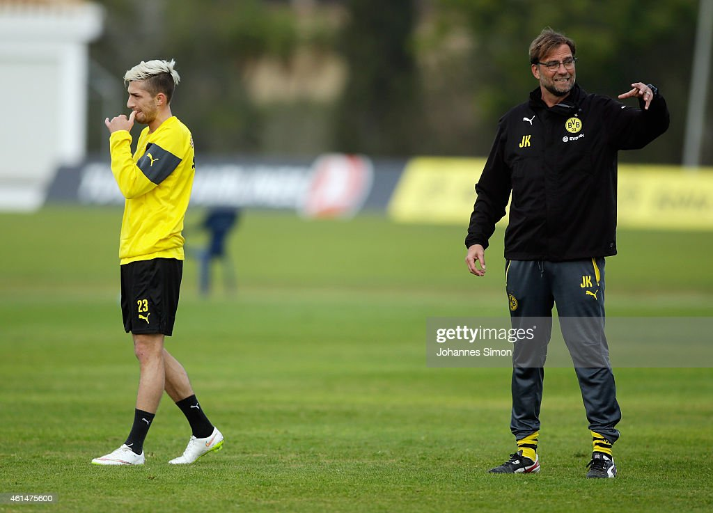 Juergen Klopp (R; beside <a gi-track='captionPersonalityLinkClicked' href=/galleries/search?phrase=Kevin+Kampl&family=editorial&specificpeople=6527116 ng-click='$event.stopPropagation()'>Kevin Kampl</a>), head coach of Borussia Dortmund (BVB) reacts during the morning training session during day 4 of the Borussia Dortmund training camp on January 13, 2015 in La Manga, Spain.
