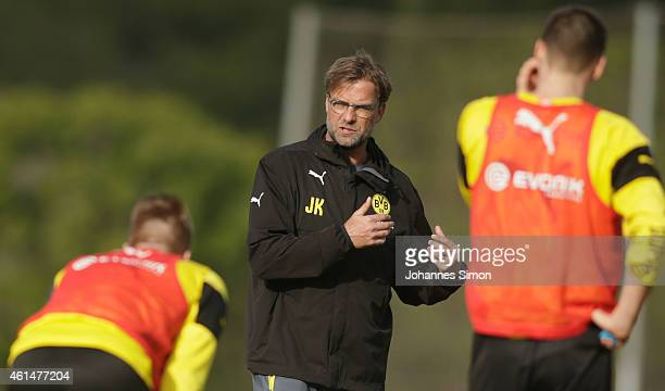 Juergen Klopp head coach of Borussia Dortmund talks to his team during the morning training session in the Borussia Dortmund training camp during day...
