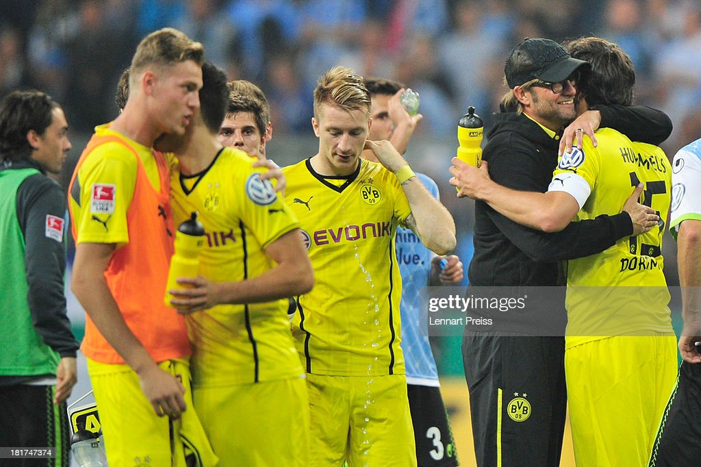Juergen Klopp (2nd R), head coach of Dortmund and his team celebrate the victory after the DFB Cup match between TSV 1860 Muenchen and Borussia Dortmund at Allianz Arena on September 24, 2013 in Munich, Germany.