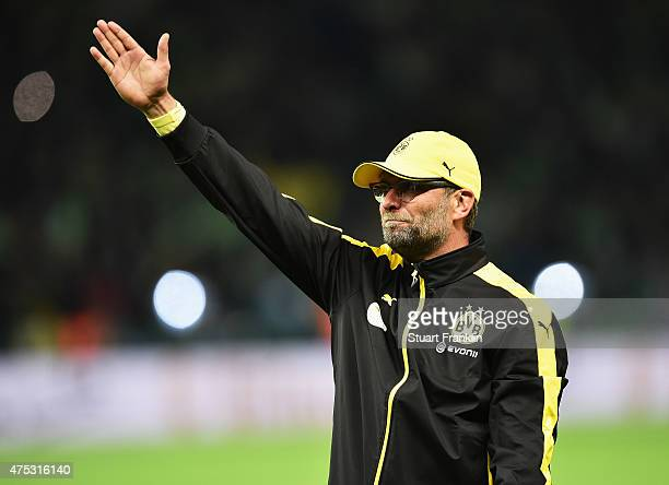 Juergen Klopp head coach of Dortmund blows a kiss to fans at the end ofthe DFB Cup Final between Borussia Dortmund and VfL Wolfsburg at...