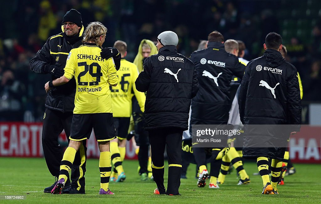 Juergen Klopp, head coach of Dortmund celebrate with <a gi-track='captionPersonalityLinkClicked' href=/galleries/search?phrase=Marcel+Schmelzer&family=editorial&specificpeople=5443925 ng-click='$event.stopPropagation()'>Marcel Schmelzer</a> after the Bundesliga match between Werder Bremen and Borussia Dortmund at Weser Stadium on January 19, 2013 in Bremen, Germany.