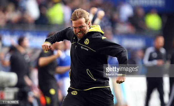 Juergen Klopp head coach of Dortmund celebrates his team's equalizing goal during the Bundesliga match between Hamburger SV and Borussia Dortmund at...