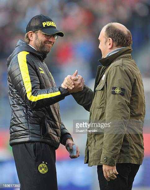 Juergen Klopp head coach of Dortmund greets Joerg Schmadtke manager of Hannover during the Bundesliga match between Hannover 96 and Borussia Dortmund...