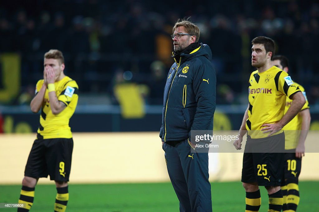 Juergen Klopp, head coach of Dortmund reacts with his players <a gi-track='captionPersonalityLinkClicked' href=/galleries/search?phrase=Ciro+Immobile&family=editorial&specificpeople=5820229 ng-click='$event.stopPropagation()'>Ciro Immobile</a> (L) and Sokratis after the Bundesliga match between Borussia Dortmund and FC Augsburg at Signal Iduna Park on February 4, 2015 in Dortmund, Germany.