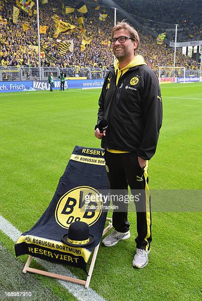 Juergen Klopp head coach of Dortmund stands by a chair with a beach towel to reserve a place prior to the Bundesliga match between Borussia Dortmund...