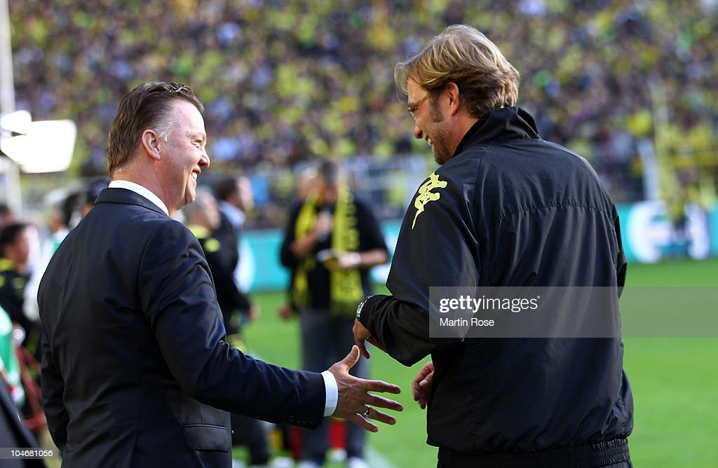 Juergen Klopp (R), head coach of Dortmund talks to Louis van Gaal (L), head coach of Muenchen before the Bundesliga match between Borussia Dortmund and FC Bayern Muenchen at the Signal Iduna Park on October 3, 2010 in Dortmund, Germany.
