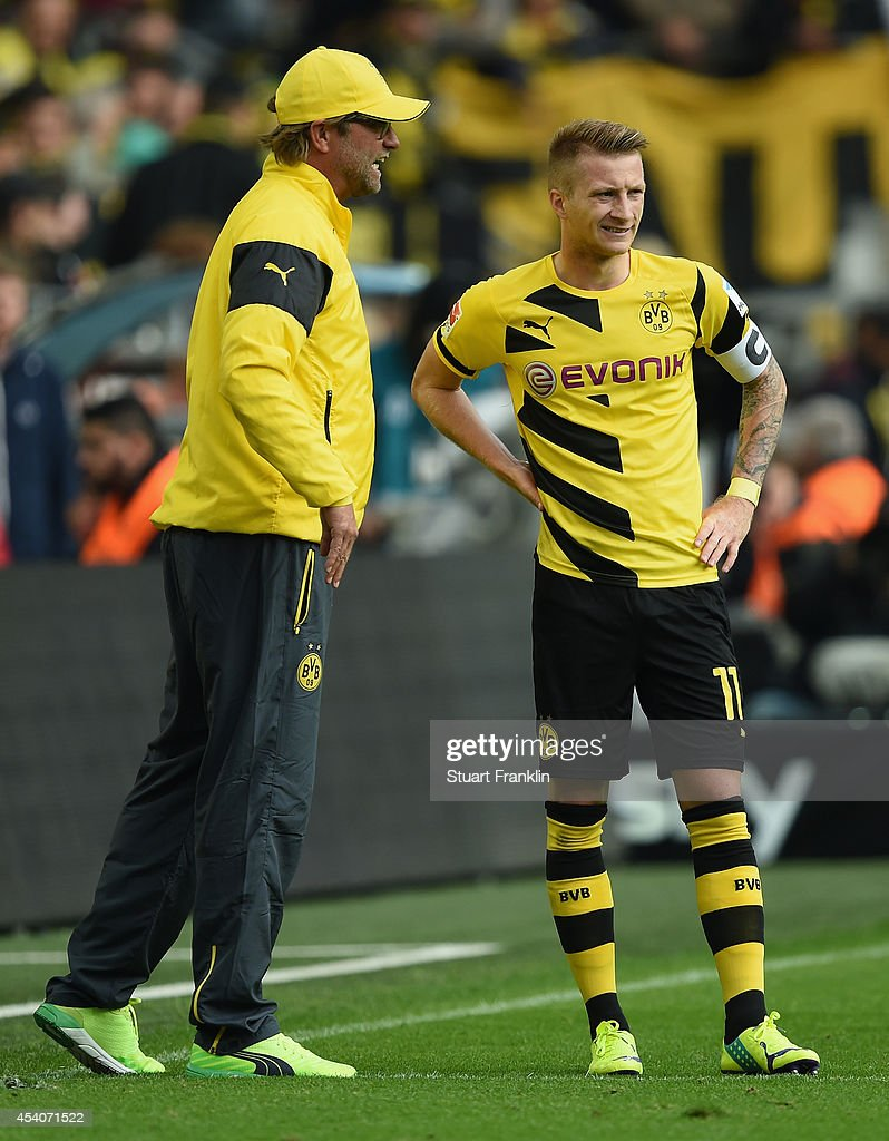 Juergen Klopp, head coach of Dortmund talks with <a gi-track='captionPersonalityLinkClicked' href=/galleries/search?phrase=Marco+Reus&family=editorial&specificpeople=5445884 ng-click='$event.stopPropagation()'>Marco Reus</a> during the Bundesliga match between Borussia Dortmund and Bayer 04 Leverkusen at Signal Iduna Park on August 23, 2014 in Dortmund, Germany.
