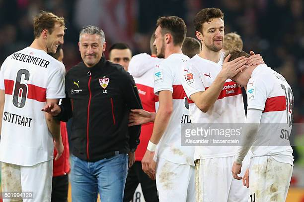Juergen Kramny head coach of Stuttgart celebrates victory with his players after winning the Bundesliga match between VfB Stuttgart and VfL Wolfsburg...