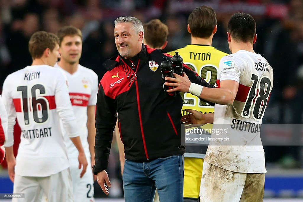 Juergen Kramny, head coach of Stuttgart celebrates victory with his palyer Filip Kostic after winning the Bundesliga match between VfB Stuttgart and Hertha BSC Berlin at Mercedes-Benz Arena on February 13, 2016 in Stuttgart, Germany.