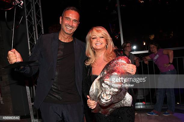 Juergen Reiter KARE Founder and CEO and Bonnie Tyler attend the grand opening of KARE Kraftwerk on October 9 2014 in Munich Germany