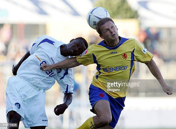 BRAUNSCHWEIG GERMANY SEPTEMBER Juergen Rische of Braunschweig challenges for the ball with Godfried Aduobe of Karlsruhe during the Second Bundesliga...