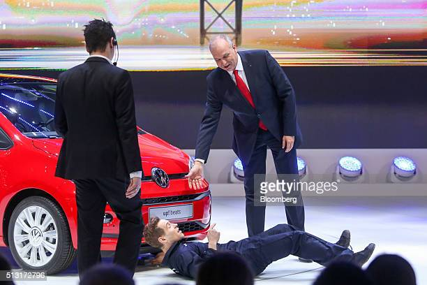 Juergen Stackman sales chief of Volkswagen AG offers a hand to Simon Brodkin comedian during a protest at a news conference on the first day of the...