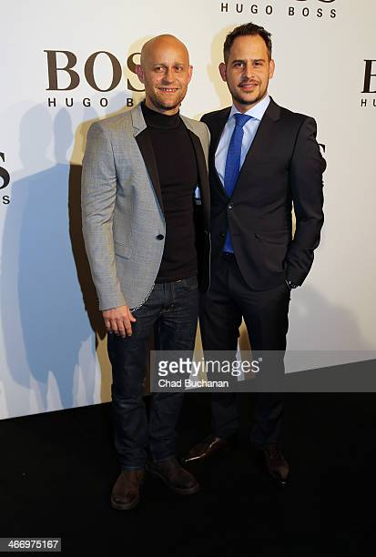 Juergen Vogel and Moritz Bleibtreu attend Hugo Boss Exhibition 'A personal touch' on February 5 2014 in Berlin Germany