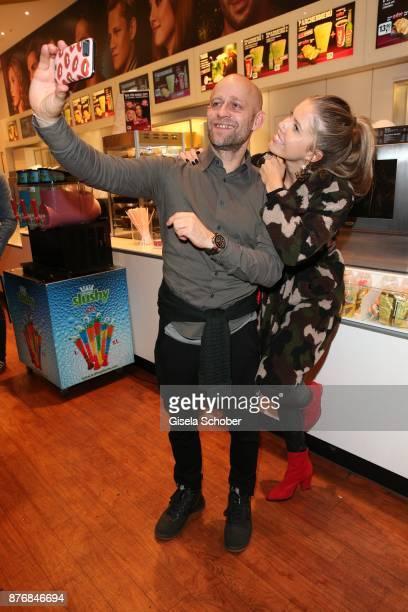 Juergen Vogel and Victoria Swarovski take a selfie during the premiere of 'Der Mann aus dem Eis' at Cinemaxx on November 20 2017 in Munich Germany
