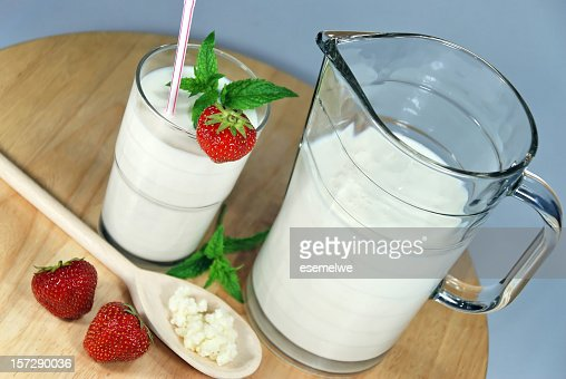 Jug and glass of kefir, decorated with fresh strawberries : Stock Photo