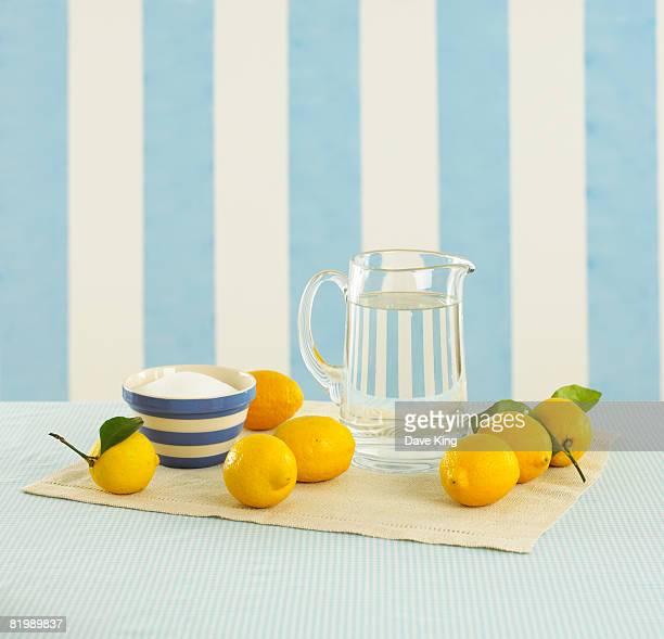 Jug of water, lemons and bowl of sugar