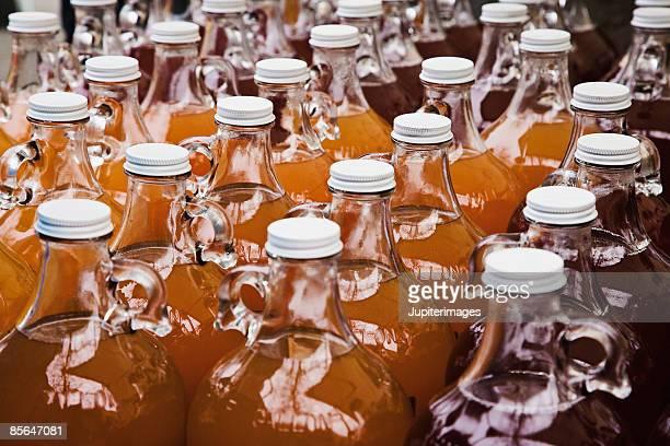 Jugs of fresh apple juice at farmer's market