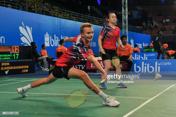 Juha Honkanen and Pihla Lindberg of Finland compete against Jona Van Nieuwkerke and Joke De Langhe of Belgium during Mixed Double qualification round...