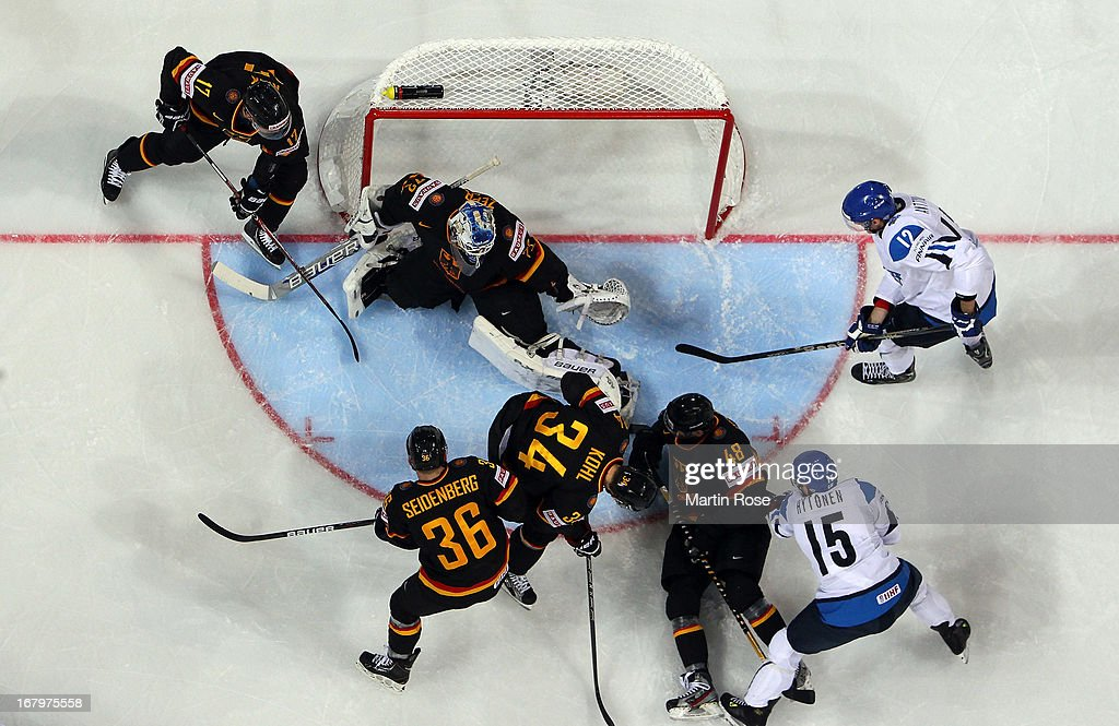 Juha Hytonen (#15) of Finland faisl to score over <a gi-track='captionPersonalityLinkClicked' href=/galleries/search?phrase=Rob+Zepp&family=editorial&specificpeople=3121630 ng-click='$event.stopPropagation()'>Rob Zepp</a> (C), goaltender of Germany during the IIHF World Championship group H match between Finland and Germany at Hartwall Areena on May 3, 2013 in Helsinki, Finland.