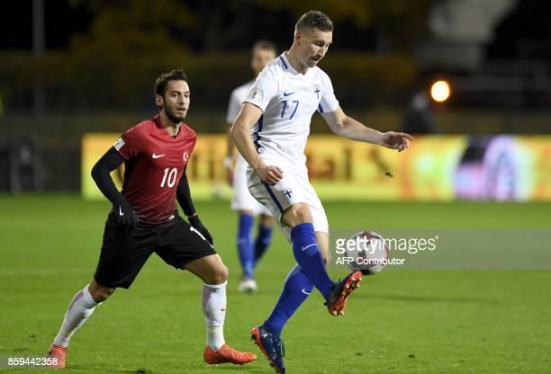 Juha Pirinen of Finland controls the ball ahead of Hakan Calhanoglu of Turkey vie for the ball during the FIFA World Cup 2018 qualifying football...