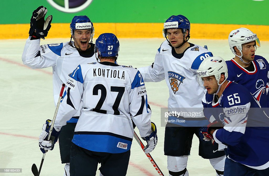 Juhamatti Aaltonen (L) of Finland celebrate with his team mates after he scores his team's 2nd goal during the IIHF World Championship group H match between Finland and France at Hartwall Areena on May 6, 2013 in Helsinki, Finland.